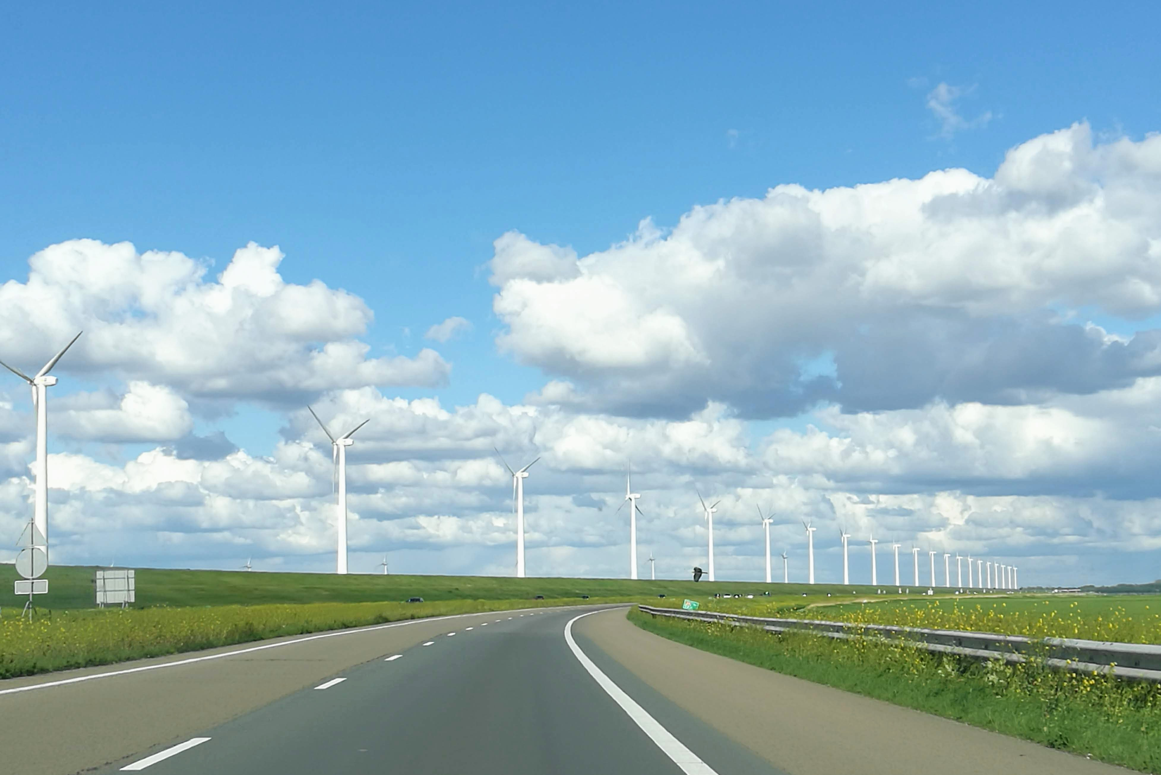 Polder of Flevoland. It shows the modern windmills and great cloud sceneries the area is well known for.