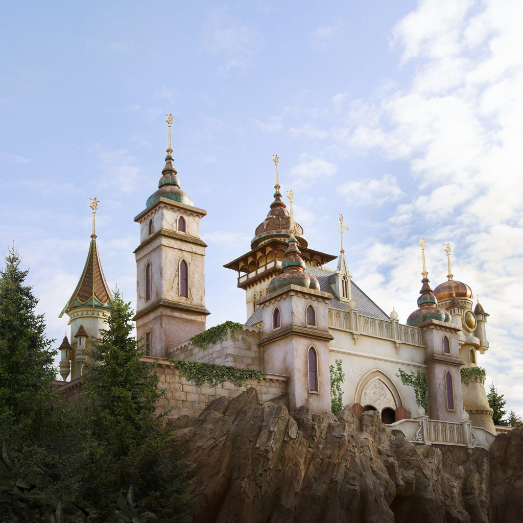One of the attractions of Dutch theme park Efteling, called Symbolica. The castle is on a high rock plateau and is white, with gold accents.