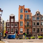 An impression of what you will see in Amsterdam, like these canal houses. This location is a part of the Holland Highlights and Amsterdam tours.