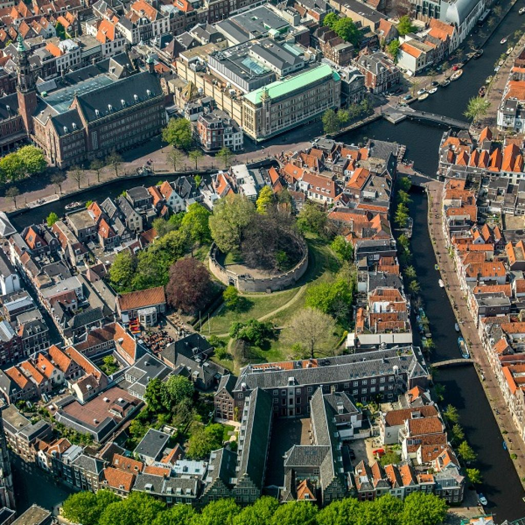 sky view Leiden city center, canals, orange rooftops, green trees, the Burcht