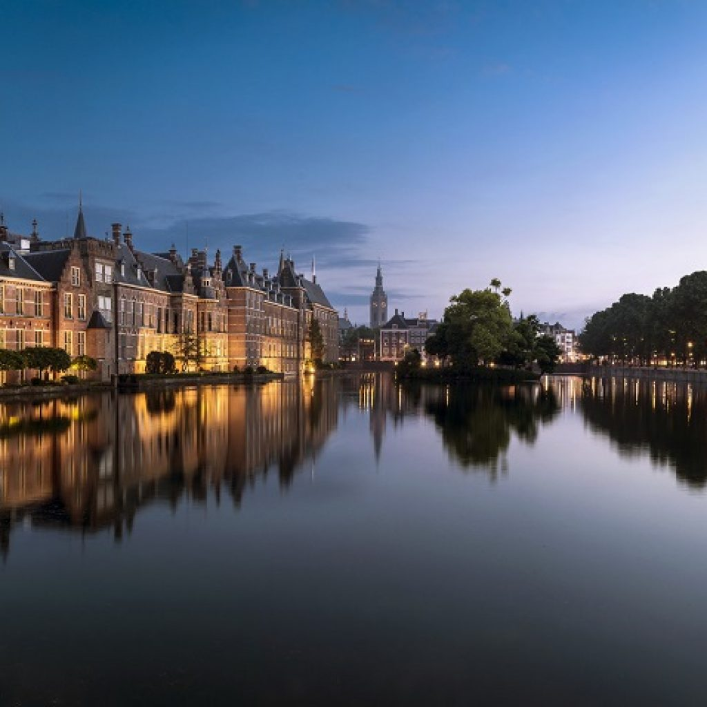 The Hague evening sky, water, reflection of governmental buildings, little Island with trees at the back